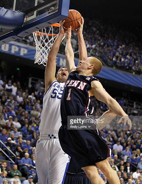 Josh Harrellson of the Kentucky Wildcats shoots the ball while defended by Zack Rosen of the Penn Quakers at Rupp Arena on January 3 2011 in...