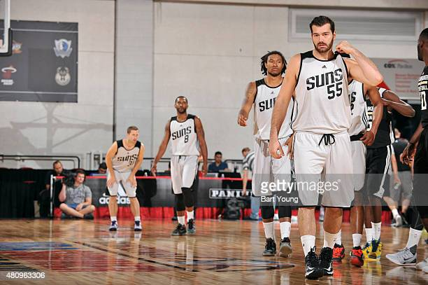 Josh Harrellson of the Phoenix Suns stands on the court during a game against the Milwaukee Bucks during the 2015 NBA Las Vegas Summer League game on...