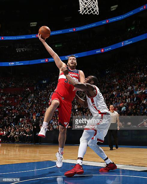 Josh Harrellson of the Washington Wizards drives to the basket against the Toronto Raptors at the Centre Bell on October 23 2015 in Montreal Quebec...