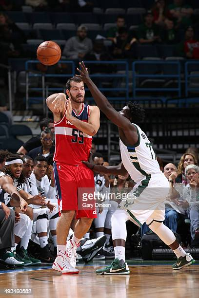Josh Harrellson of the Washington Wizards passes the ball against the Milwaukee Bucks during a preseason game on October 17 2015 at the BMO Harris...