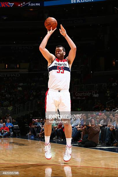 Josh Harrellson of the Washington Wizards shoots against the New York Knicks during a preseason game on October 9 2015 at Verizon Center in...