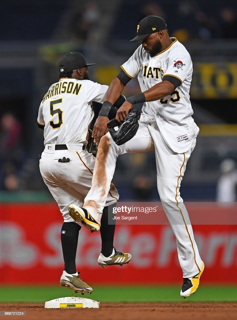 Josh Harrison #5 and Gregory Polanco #25 of the Pittsburgh Pirates celebrate after a 11-9 win over the Los Angeles Dodgers at PNC Park on June 6, 2018 in Pittsburgh, Pennsylvania.