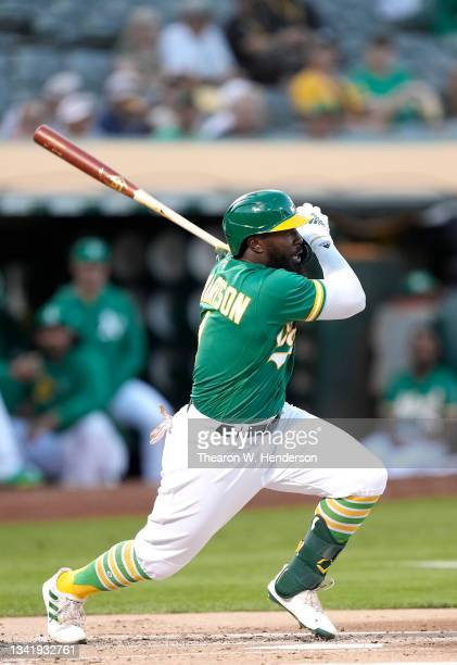 Josh Harrison of the Oakland Athletics bats against the Seattle Mariners in the bottom of the first inning at RingCentral Coliseum on September 21,...