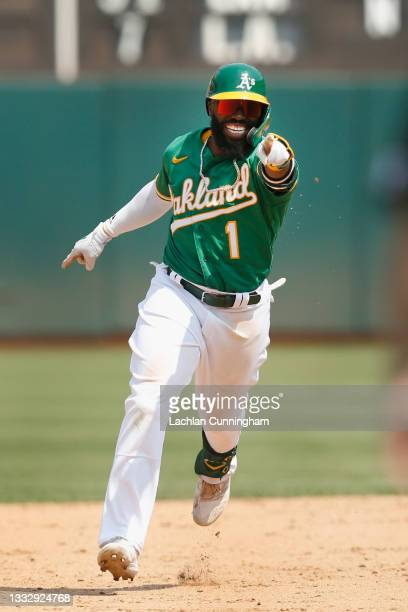 Josh Harrison of the Oakland Athletics celebrates after hitting a two-run home run in the bottom of the fifth inning against the Texas Rangers at...