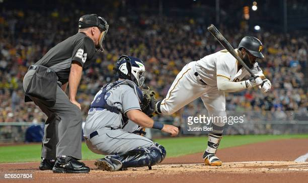 Josh Harrison of the Pittsburgh Pirates attempts to get out of the way of an inside pitch in the first inning during the game against the San Diego...