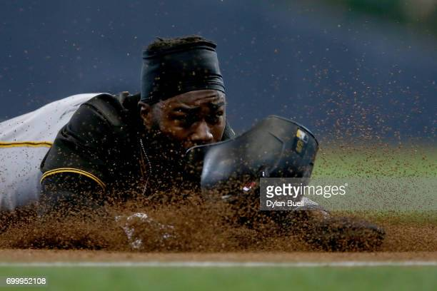 Josh Harrison of the Pittsburgh Pirates attempts to steal third base in the sixth inning against the Milwaukee Brewers at Miller Park on June 22 2017...