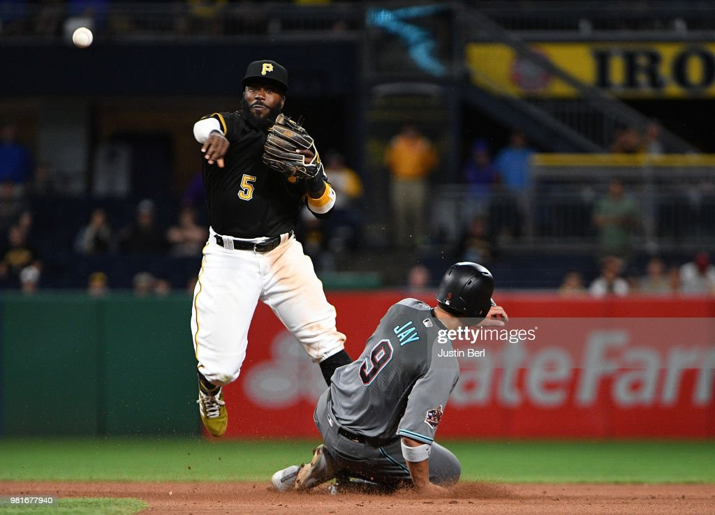 Josh Harrison #5 of the Pittsburgh Pirates attempts to turn a double play on Jon Jay #9 of the Arizona Diamondbacks in the eleventh inning during the game at PNC Park on June 22, 2018 in Pittsburgh, Pennsylvania.