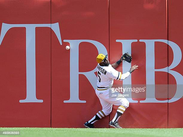 Josh Harrison of the Pittsburgh Pirates can't make a catch on a ball hit by Anthony Rendon of the Washington Nationals during the fifth inning on May...