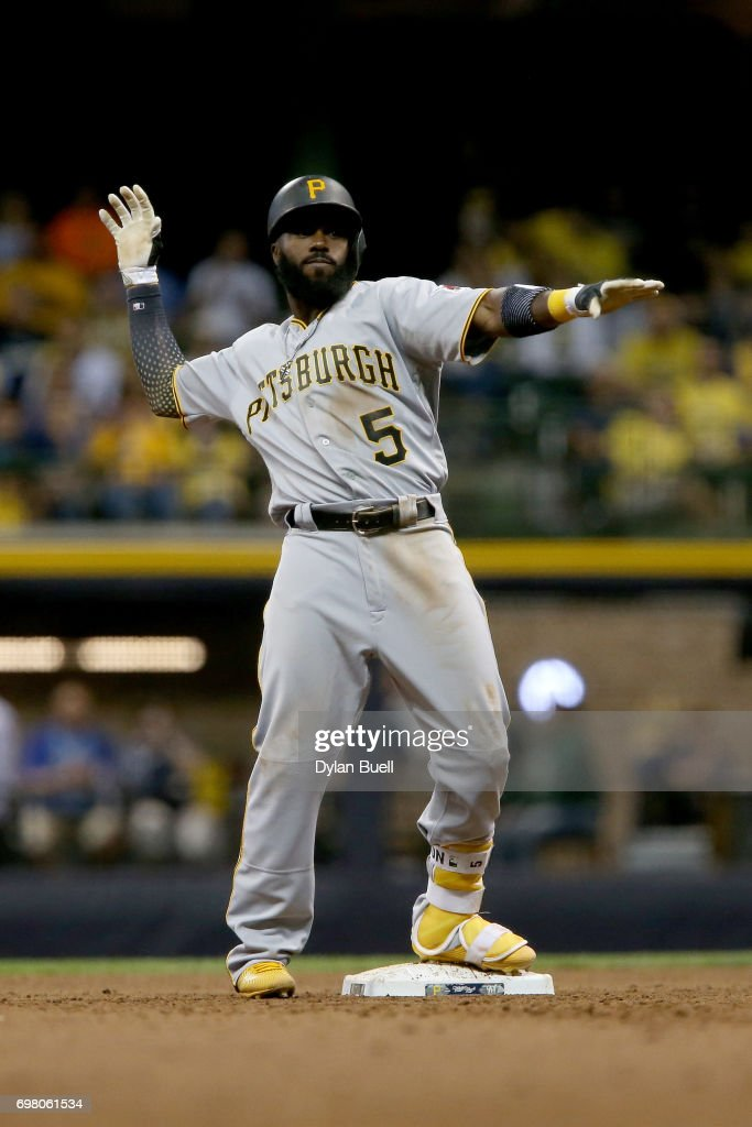 Josh Harrison #5 of the Pittsburgh Pirates celebrates after hitting a double in the seventh inning against the Milwaukee Brewers at Miller Park on June 19, 2017 in Milwaukee, Wisconsin.