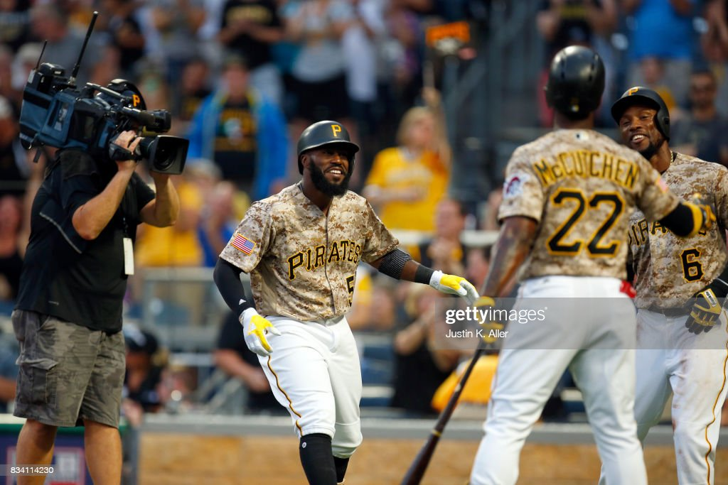 Josh Harrison #5 of the Pittsburgh Pirates celebrates after hitting a two run home run in the first inning against the St. Louis Cardinals at PNC Park on August 17, 2017 in Pittsburgh, Pennsylvania.