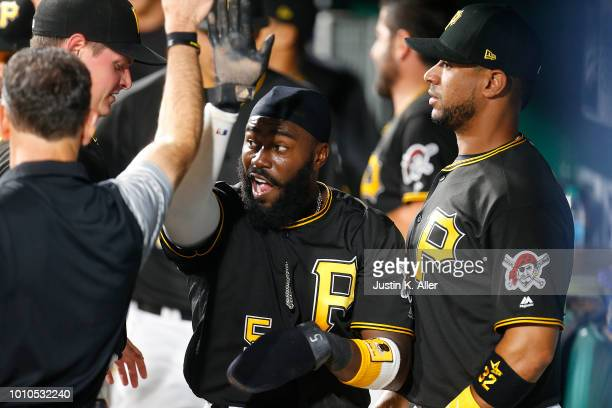 Josh Harrison of the Pittsburgh Pirates celebrates after scoring on a RBI single in the eighth inning against the St Louis Cardinals at PNC Park on...