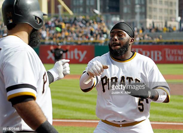 Josh Harrison of the Pittsburgh Pirates celebrates after scoring on a RBI single in the first inning during the game against the Cincinnati Reds at...