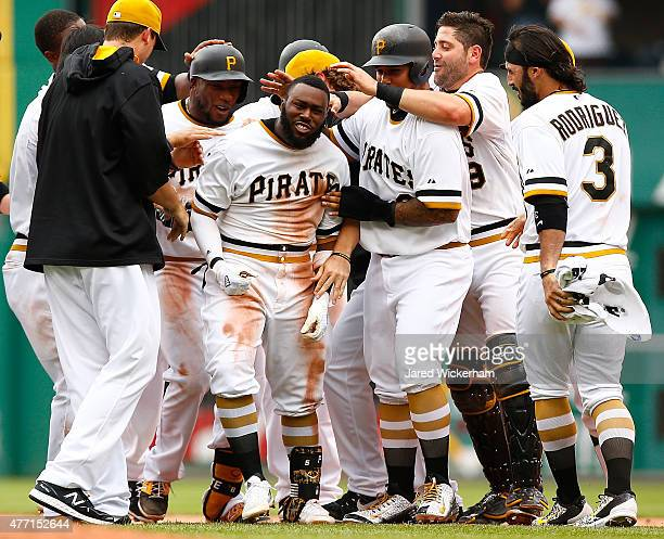 Josh Harrison of the Pittsburgh Pirates celebrates his gamewinning RBI single in the 11th inning with teammates against the Philadelphia Phillies...