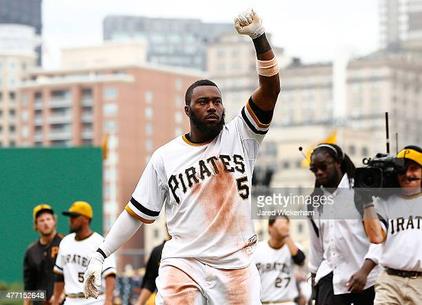 Josh Harrison of the Pittsburgh Pirates celebrates his gamewinning RBI single in the 11th inning against the Philadelphia Phillies during the game at...
