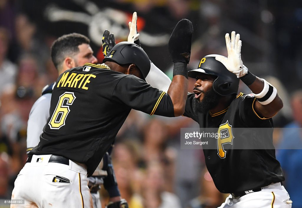 Josh Harrison #5 of the Pittsburgh Pirates celebrates his two run home run with Starling Marte #6 during the sixth inning against the Milwaukee Brewers at PNC Park on July 18, 2017 in Pittsburgh, Pennsylvania.