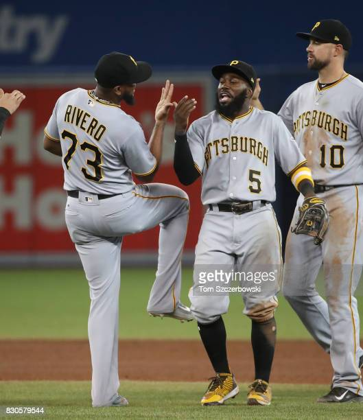Josh Harrison of the Pittsburgh Pirates celebrates their victory with Felipe Rivero during MLB game action against the Toronto Blue Jays at Rogers...