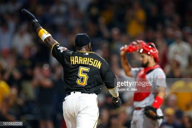Josh Harrison of the Pittsburgh Pirates celebrates while scoring on a RBI single in the eighth inning against the St Louis Cardinals at PNC Park on...