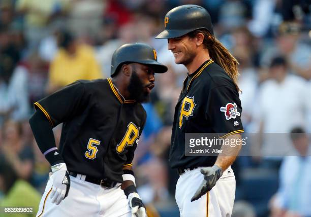 Josh Harrison of the Pittsburgh Pirates celebrates with John Jaso after hitting a solo home run in the first inning against the Washington Nationals...
