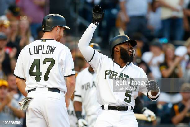 Josh Harrison of the Pittsburgh Pirates celebrates with Jordan Luplow after hitting a two run home run in the third inning against the New York Mets...