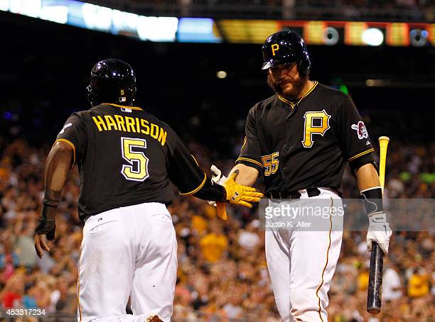 Josh Harrison of the Pittsburgh Pirates celebrates with Russell Martin after scoring on a RBI single in the fifth inning against the Miami Marlins...