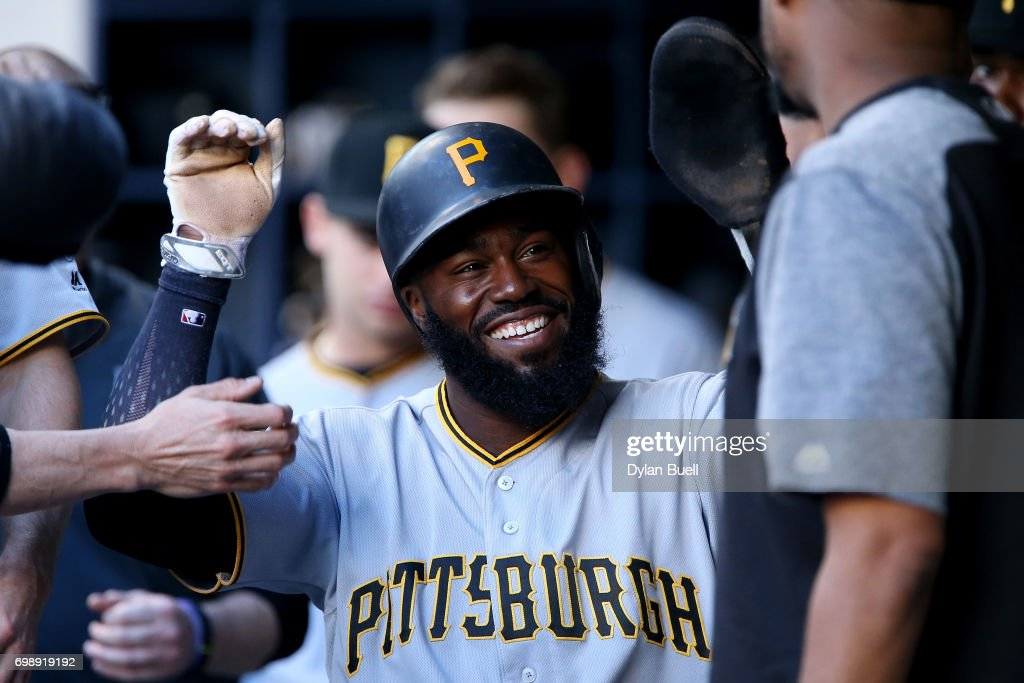 Josh Harrison #5 of the Pittsburgh Pirates celebrates with teammates after scoring a run in the first inning against the Milwaukee Brewers at Miller Park on June 20, 2017 in Milwaukee, Wisconsin.