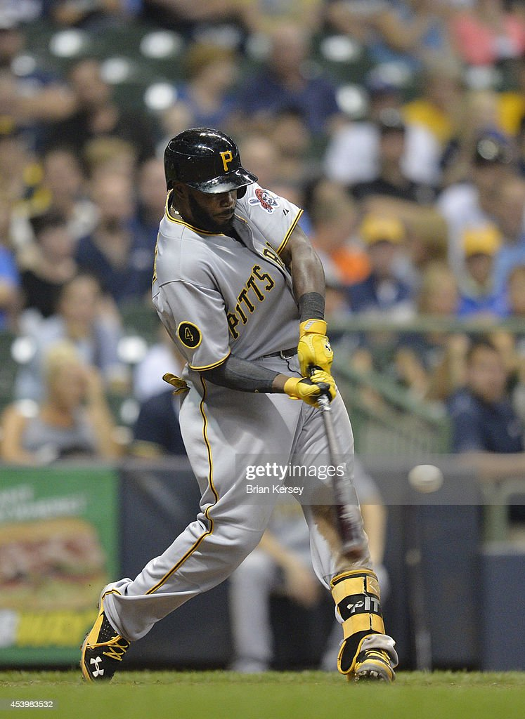 Josh Harrison #5 of the Pittsburgh Pirates connects on a two-run home run scoring teammate Starling Marte during the eighth inning against the Milwaukee Brewers at Miller Park on August 22, 2014 in Milwaukee, Wisconsin.