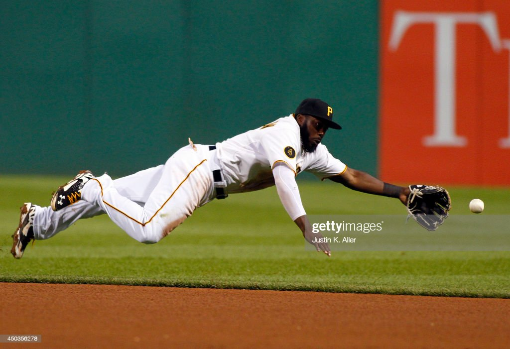 Josh Harrison #5 of the Pittsburgh Pirates dives for a ball in the seventh inning against the Chicago Cubs during the game at PNC Park on June 9, 2014 in Pittsburgh, Pennsylvania.