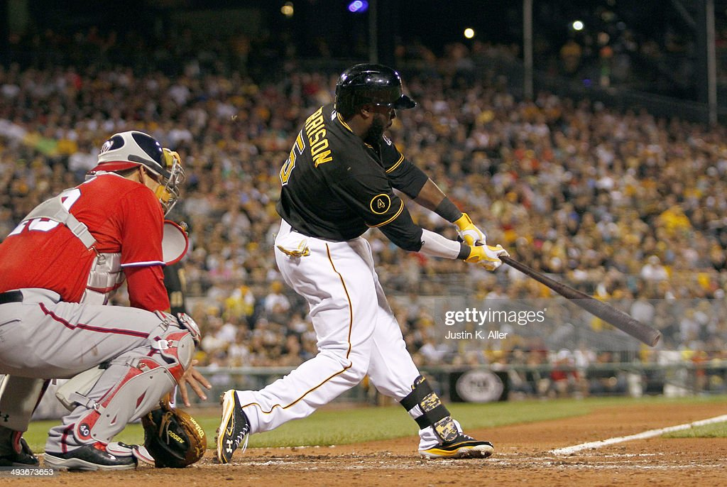 Josh Harrison #5 of the Pittsburgh Pirates hits a RBI single in the seventh inning against the Washington Nationals during the game at PNC Park May 24, 2014 in Pittsburgh, Pennsylvania.