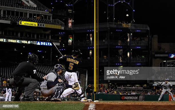 Josh Harrison of the Pittsburgh Pirates hits a two run home run in the seventh inning against the Milwaukee Brewers during the game at PNC Park April...