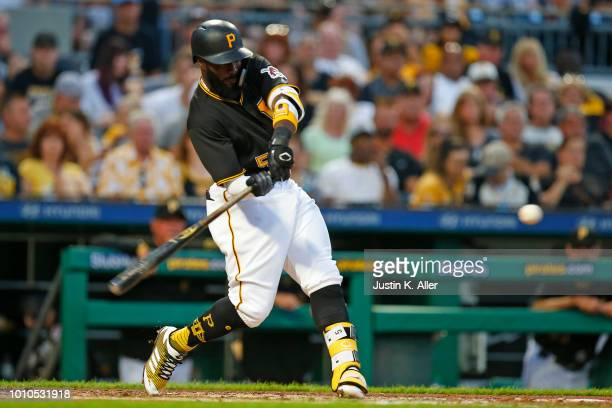 Josh Harrison of the Pittsburgh Pirates hits an RBI single in the third inning against the St Louis Cardinals at PNC Park on August 3 2018 in...