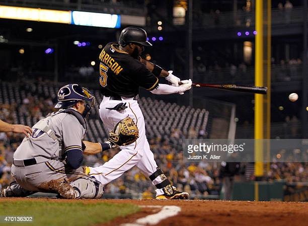 Josh Harrison of the Pittsburgh Pirates hits an RBI single in the fifth inning during the game against the Milwaukee Brewers at PNC Park on April 17...