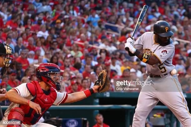 Josh Harrison of the Pittsburgh Pirates is hit by a pitch against the St Louis Cardinals in the sixth inning at Busch Stadium on June 24 2017 in St...