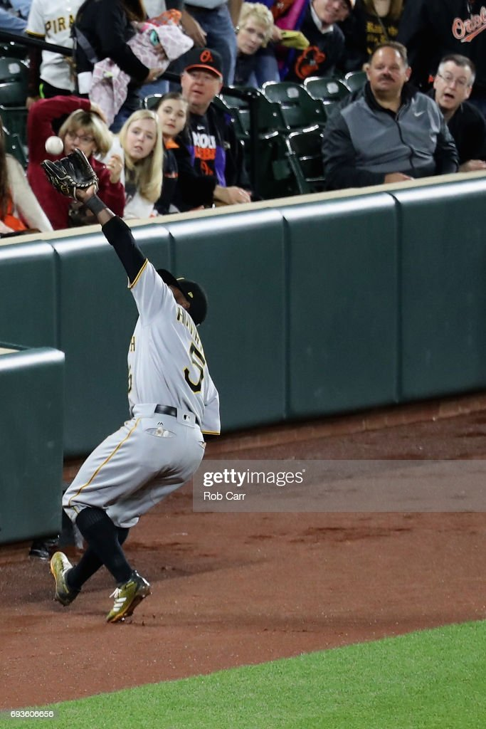 Josh Harrison #5 of the Pittsburgh Pirates makes a catch against the Baltimore Orioles at Oriole Park at Camden Yards on June 7, 2017 in Baltimore, Maryland.