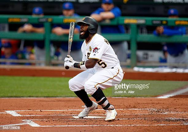 Josh Harrison of the Pittsburgh Pirates reacts after being hit by a pitch in the second inning during the game against the Chicago Cubs at PNC Park...