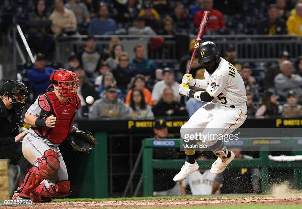 Josh Harrison of the Pittsburgh Pirates reacts after being hit by a pitch in the seventh inning during the game against the Cincinnati Reds at PNC...