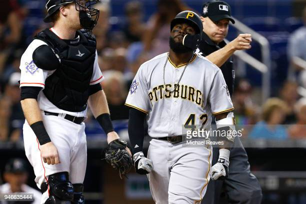 Josh Harrison of the Pittsburgh Pirates reacts after being hit by a pitch in the third inning against the Miami Marlins at Marlins Park on April 15...