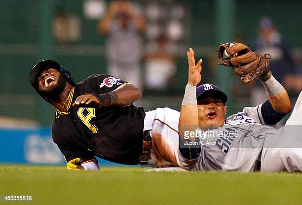 Josh Harrison of the Pittsburgh Pirates reacts after being injured while attempting to steal second base in the fifth inning against Everth Cabrera...