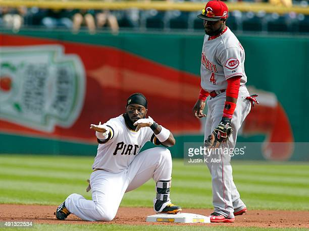 Josh Harrison of the Pittsburgh Pirates reacts after hitting a double in the first inning during the game against Brandon Phillips of the Cincinnati...