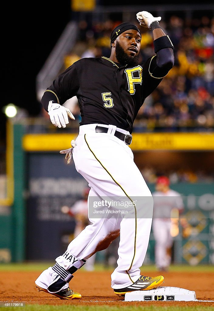 Josh Harrison #5 of the Pittsburgh Pirates reacts following his triple in the first inning against the Cincinnati Reds during the game at PNC Park on October 3, 2015 in Pittsburgh, Pennsylvania.