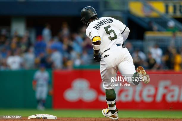 Josh Harrison of the Pittsburgh Pirates rounds second after hitting a two run home run in the third inning against the New York Mets at PNC Park on...