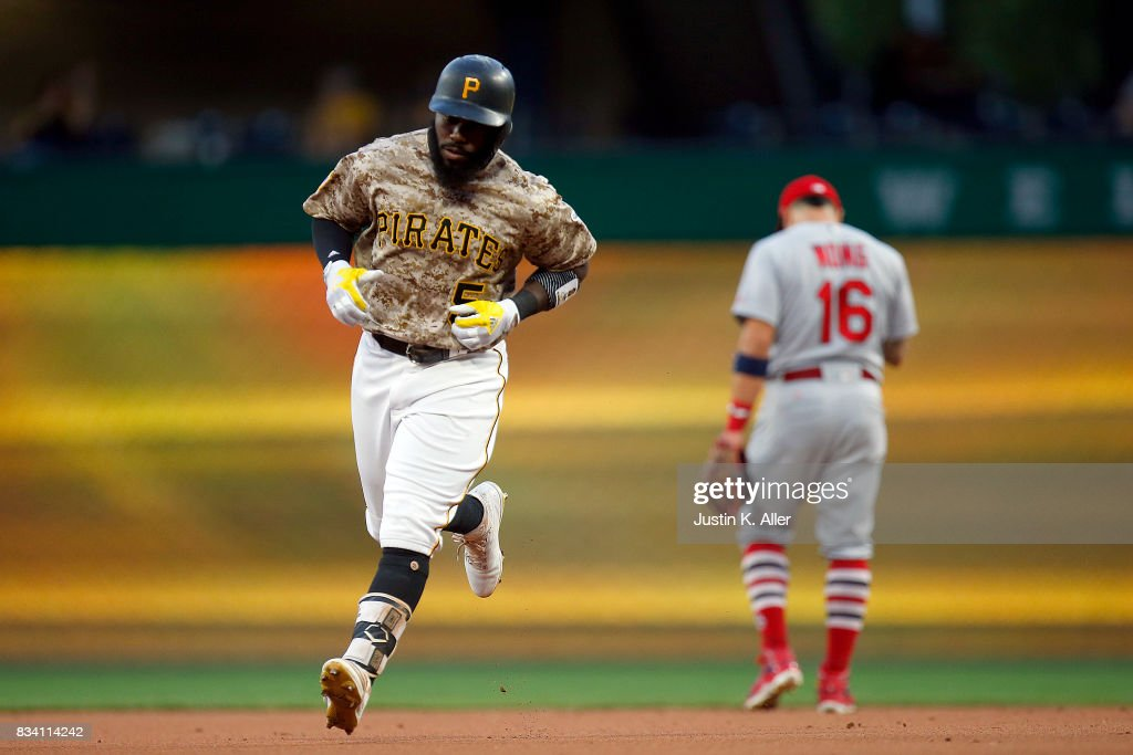 Josh Harrison #5 of the Pittsburgh Pirates rounds second after hitting a two run home run in the first inning against the St. Louis Cardinals at PNC Park on August 17, 2017 in Pittsburgh, Pennsylvania.