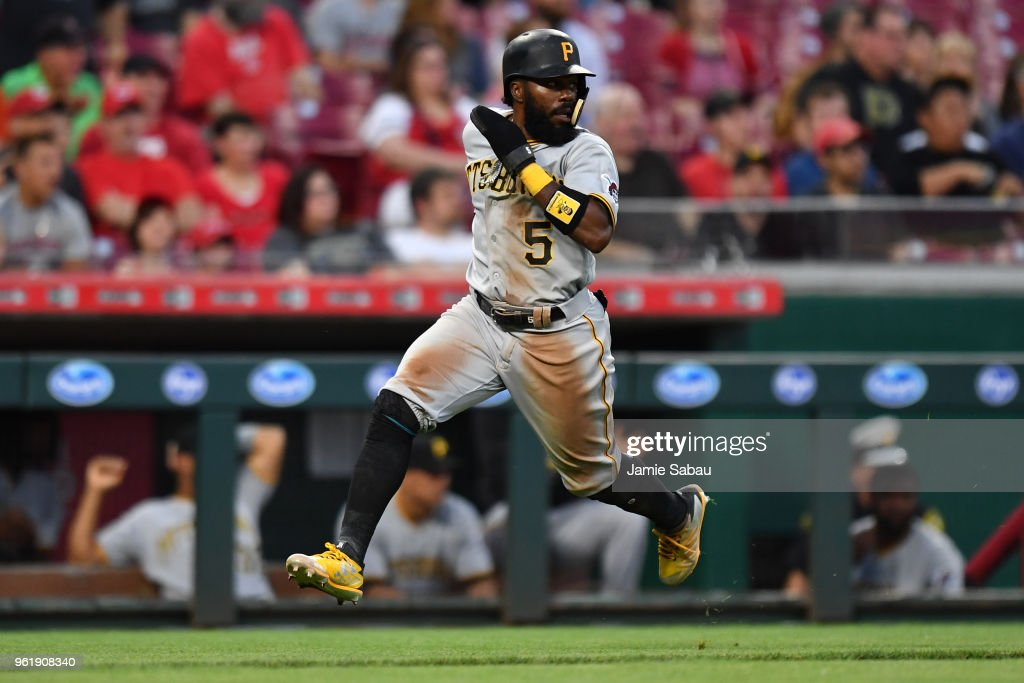 Josh Harrison #5 of the Pittsburgh Pirates scores a run in the fifth inning against the Cincinnati Reds at Great American Ball Park on May 23, 2018 in Cincinnati, Ohio. Pittsburgh defeated Cincinnati 5-4 in 12 innings.