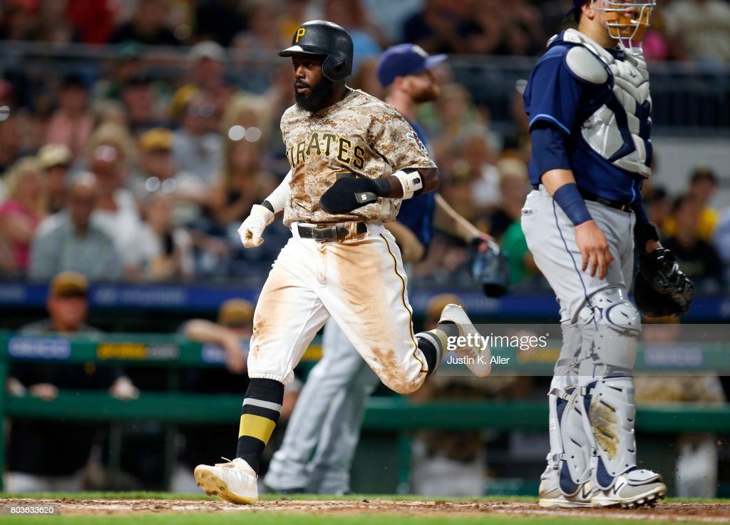 Josh Harrison #5 of the Pittsburgh Pirates scores on a RBI single in the seventh inning against the Tampa Bay Rays during inter-league play at PNC Park on June 29, 2017 in Pittsburgh, Pennsylvania.
