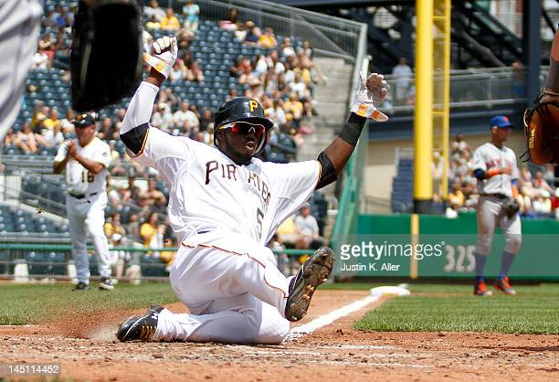 Josh Harrison of the Pittsburgh Pirates scores on an RBI single by Andrew McCutchen against the New York Mets during the game on May 23 2012 at PNC...