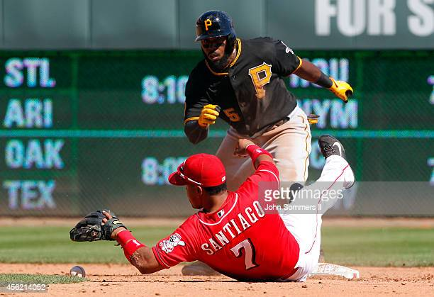 Josh Harrison of the Pittsburgh Pirates slides in safe ahead of the tag at second base by Ramon Santiago Cincinnati Reds at Great American Ball Park...