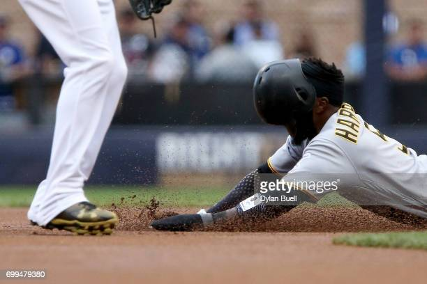 Josh Harrison of the Pittsburgh Pirates steals second base past Orlando Arcia of the Milwaukee Brewers in the first inning at Miller Park on June 21...