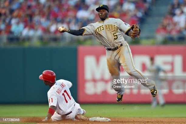 Josh Harrison of the Pittsburgh Pirates throws to first base after putting out Jimmy Rollins of the Philadelphia Phillies at Citizens Bank Park on...