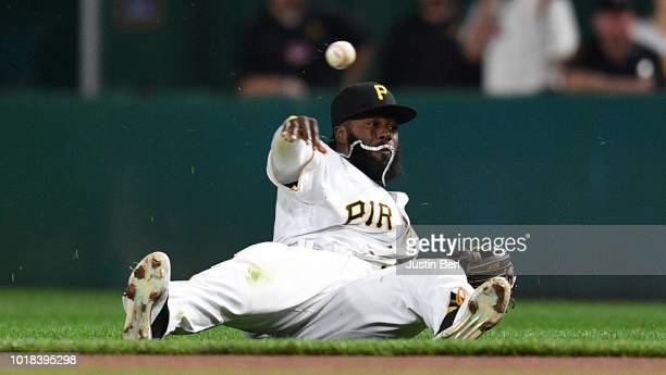 Josh Harrison of the Pittsburgh Pirates throws to first base to force out Ben Zobrist of the Chicago Cubs in the first inning during the game at PNC...
