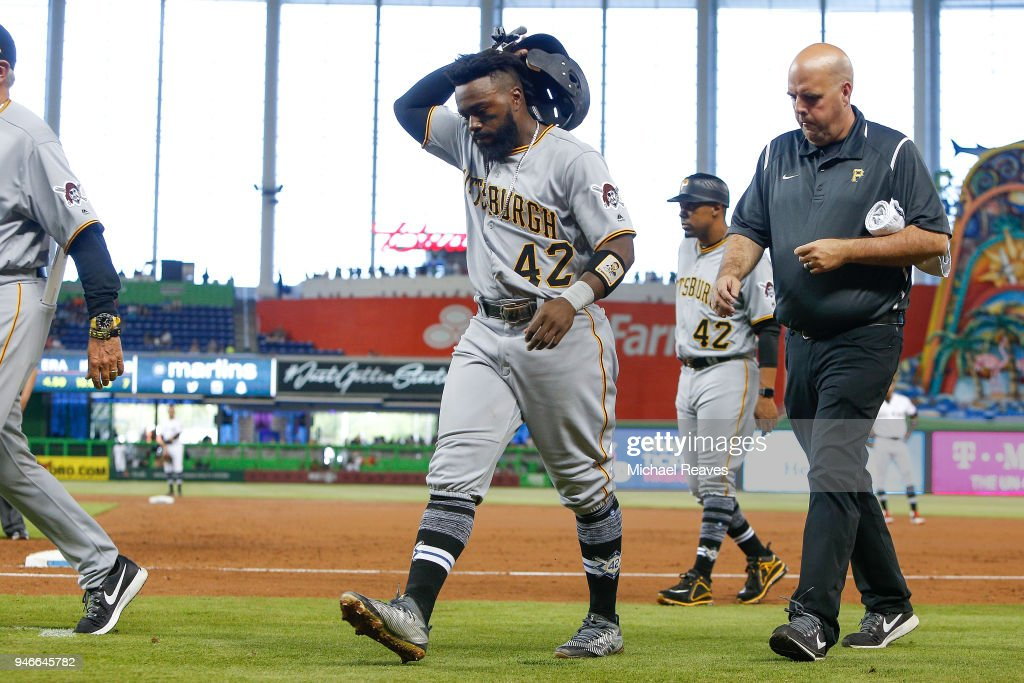 Josh Harrison #5 of the Pittsburgh Pirates walks off the field after being taken out of the game in the third inning due to injury against the Miami Marlins at Marlins Park on April 15, 2018 in Miami, Florida. All players are wearing #42 in honor of Jackie Robinson Day.