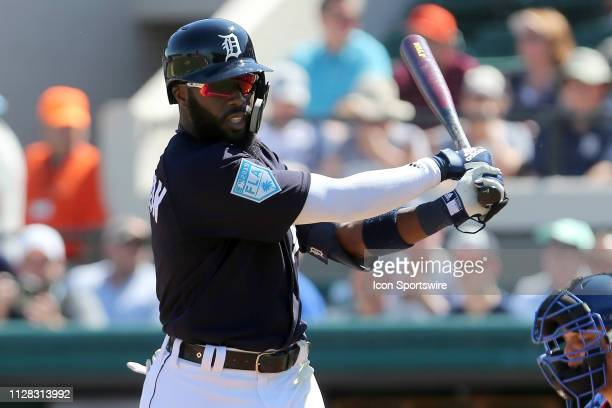 Josh Harrison of the Tigers stretches before stepping into the batter's box during the spring training game between the New York Mets and the Detroit...